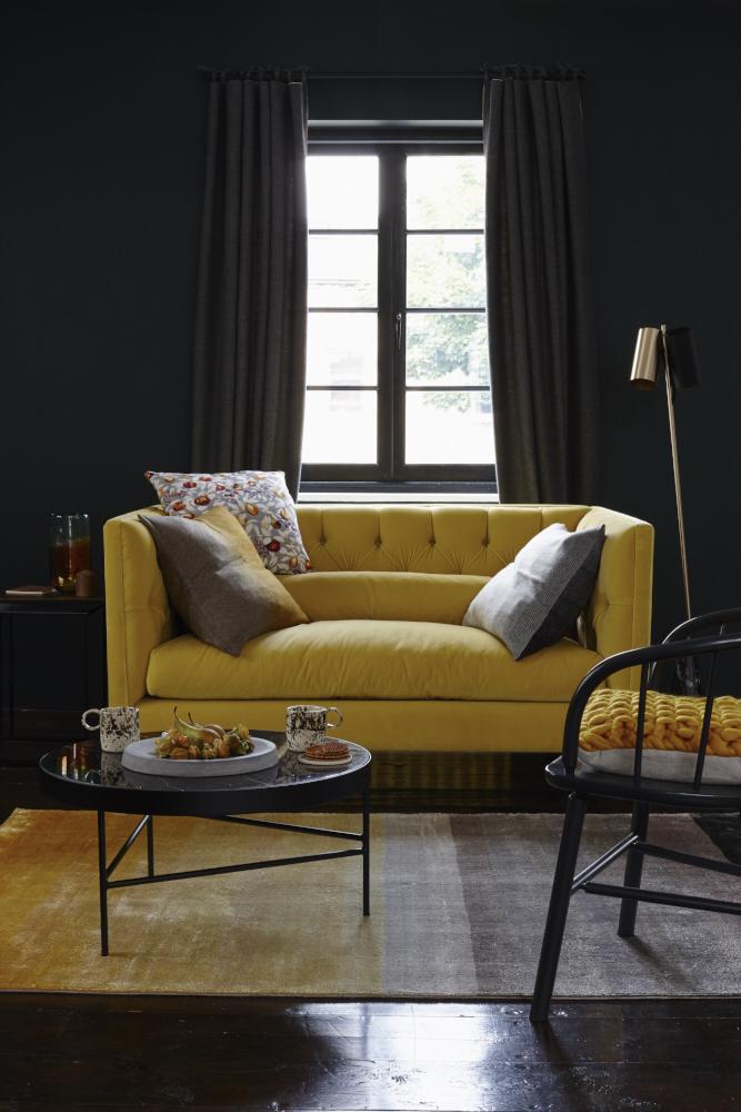 mustard yellow velvet sofa grey cushions gold vintage lamp