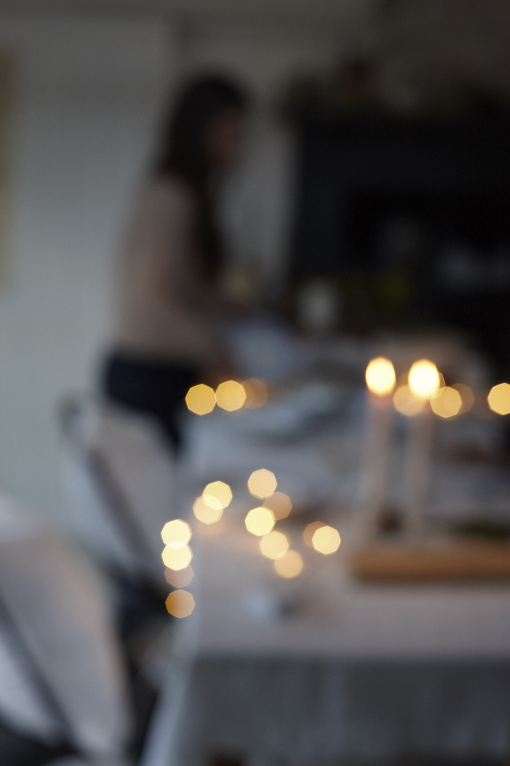 festive atmospheric dining table created by interiors photographer and still life photographer joanna henderson