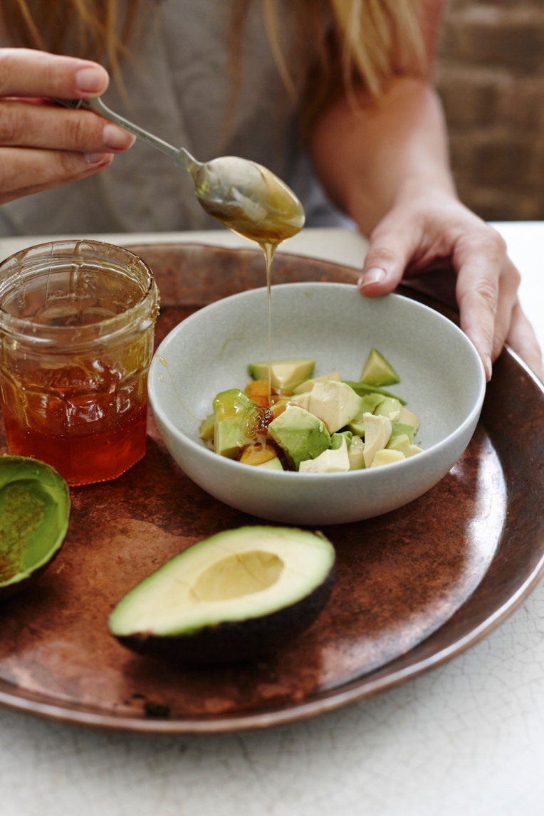 Cleansing and softening avocado and manuka honey facemask. Food photography by Joanna Henderson