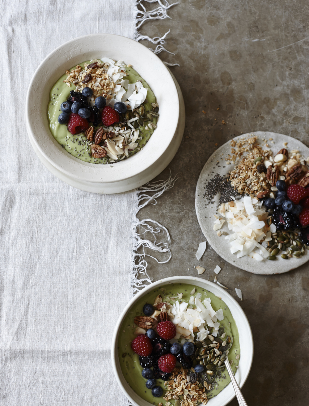 Avocado, coconut and berry breakfast bowls. Food photography from Joanna Henderson for Kyle Books
