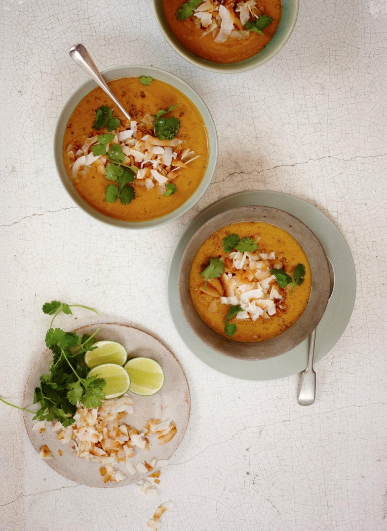 Squash and coconut soup with a coriander and lime garnish. Food photography by Joanna Henderson