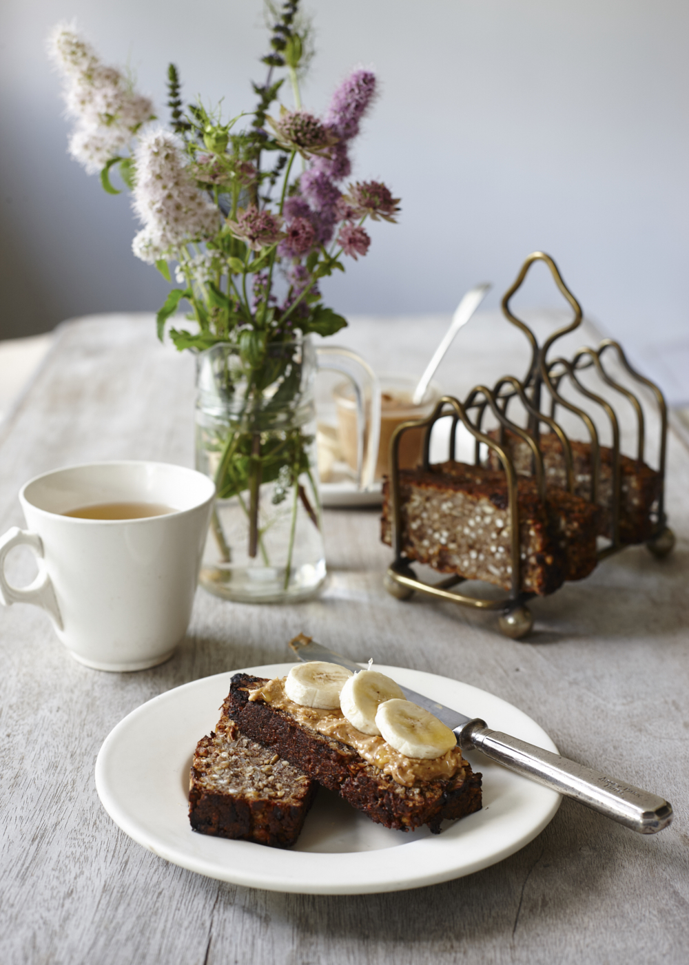Freshly baked loaf topped with banana and peanut butter. Food photography by Joanna Henderson