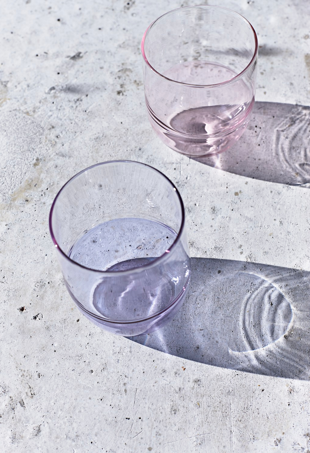Lilac and pink pastel coloured glass tumblers for the Tate. Still life photography by Joanna Henderson