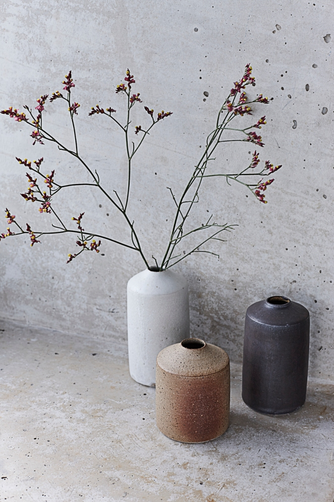 Ceramic vases and concrete. Still life photography by Joanna Henderson