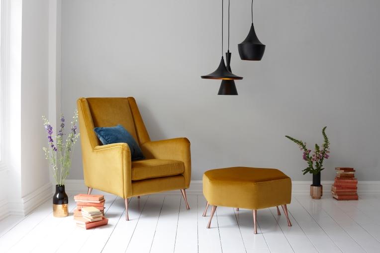 Mustard velvet armchair with footstool. Interior photography by Joanna Henderson