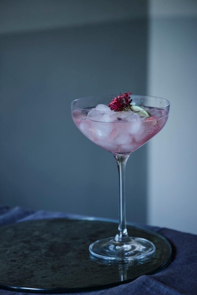 Pink cocktail served in a cocktail glass