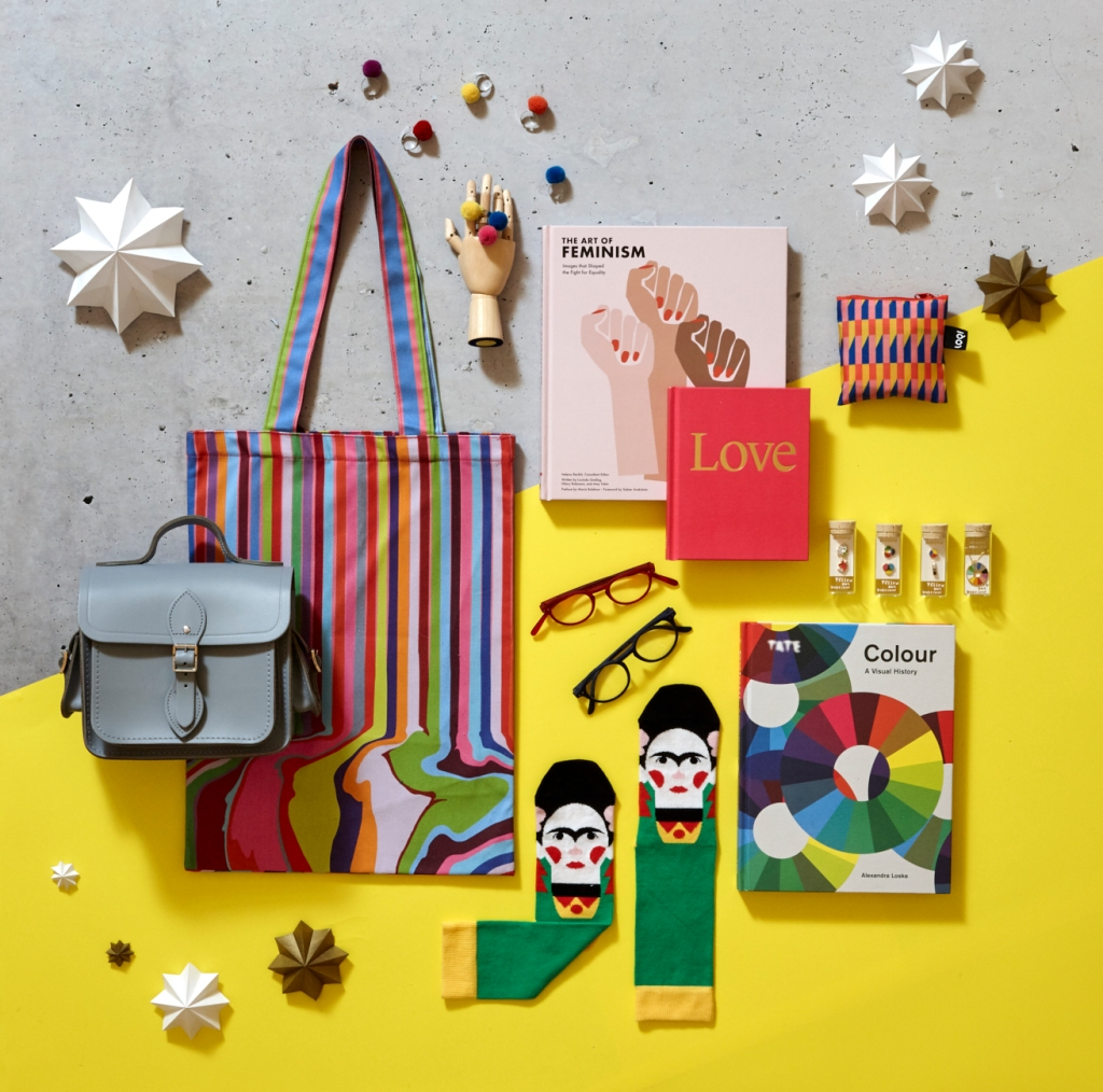 Christmas gifts from the Tate shop. A greay leather satchel, tote bag, glasses, Frida Khalo socks and pom pom rings.